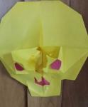 3-D Skull with helmet eyes and scissor shape