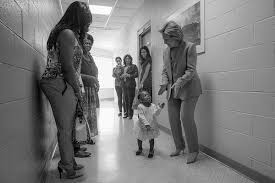 Hillary dancing with little girl